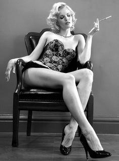 Woman smoking a cigarette with  a long filter.  #noir #noirnation