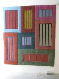 "Peter Haley, Director of Graduate Studies Painting and Printmaking at Yale, designed a colorblock rug, ""Prisons"" that mixes intense and soft colors."