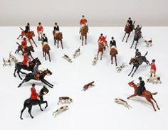 Handpainted vintage British foxhunting figurines circa 1930's. These would be fun running across the fireplace mantel or along a table set for Christmas dinner --- or a formal meal with the hunt club hosted at my house.
