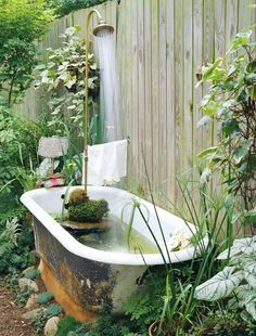 Make an old claw-foot tub into a backyard fountain-pond hybrid.  And 19 other ideas!!!
