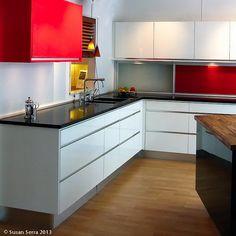White modern kitchen with red accents www.thekitchendesigner.org