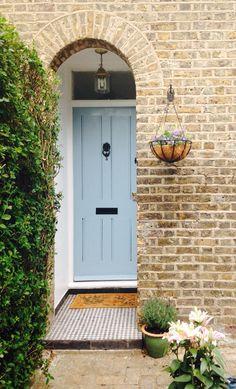 Front door- gentle blue/duck egg. Victorian house with hanging basket.