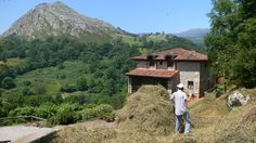 Stacking hay at the wild flower meadow at Hotel Posada del Valle