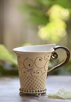 Ceramic Mug, Tea Mug, Handbuilt Mug, Coffee cup, Unique cup This is the perfect cup for your morning hot coffe or tea. The handle is fired with gold bronze glazed color. This teacup is handmade in my art pottery studio in eastern europe. Made of white clay, hand carved design and