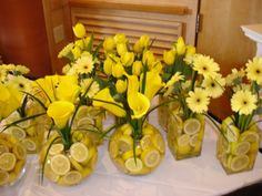 Using foods for your centerpieces. Could add some lemony-fresh scent to your venue, too!