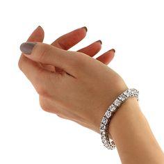 This Beautiful Round Cut Diamond Tennis Bracelet Features Almost Twenty Two Carats Of Brilliant Diamonds