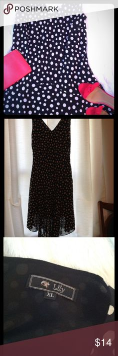 Lilly Flared black and white polka dot dress. XL Lily dress chiffon back dress with white polka dot. Black lined. Nice shape. Side zipper.  Below knee. Lily Dresses Midi