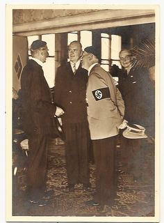 """"""" Very rare candid of Hitler during the Munich conference in September, 1938. This was not taken by Hoffmann, but by someone in the British delegation. Hitler is pretending to listen to Chamberlain while Paul Schmidt translates...."""