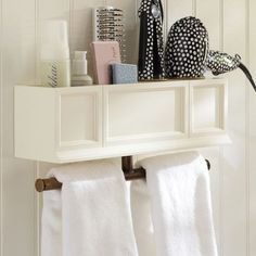 Whip your bathroom into shape with this hair accessories mounted organizer.