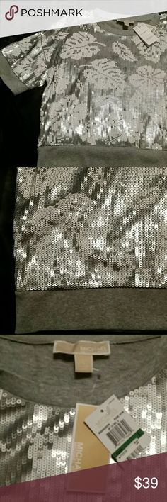 NWT Michael Kors silver sequin top  Size large New with tags! Silver and gray tropical flower sequin knit top from Michael Michael Kors. Perfect for all seasons. Size XL. MICHAEL Michael Kors Tops
