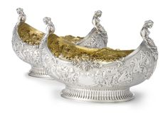 A Pair of Victorian Silver Dessert Bowls, Charles Stuart Harris, London, 1897 of boat form chased with strapwork and festoons against a matted ground, both sides centered by cartouches, the ends with female caryatids holding palm fronds, gilt interiors