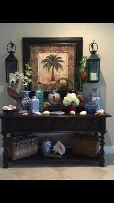 Tropical entry. British colonial. Palm tree decor. Blue and white pottery and coastal elements. Ginger Jars.