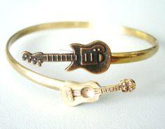 guitars music bracelet. #fashion #music #style #bracelet #jewelry #musicfashion #guitar http://www.pinterest.com/TheHitman14/hey-ladies-musical-fashion/