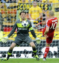 ~ Roman Weidenfeller the FEARLESS goalkeeper of Borussia Dortmund against Arjen Robben of Bayern Munchen in the Champions League Finals at New Wembley on 25 May 2013 ~