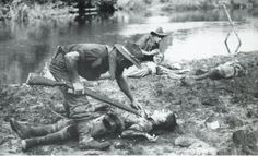 Australian soldiers searching Japanese dead, North Borneo, June 1945.