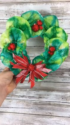 Coffee Filter Wreath Kids Craft This Coffee Filter Wreath is a cute Christmas craft for kids. Transform coffee filters and a paper plate into a colorful wreath decoration. Kindergarten Christmas Crafts, Christmas Art Projects, Christmas Crafts For Kids, Holiday Crafts, Preschool Crafts, Christmas Wreaths, Spring Crafts, Coffee Filter Art, Coffee Filter Wreath