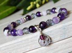 About the Bracelet A delicate blend of purples. This feminine bracelet is stunning with amethyst gemstones and high quality glass beads combined. A must have for people who love purple. Bracelet Detai
