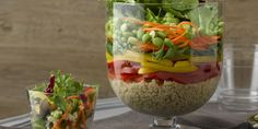 Uses DOLE® 50/50 Salad Blend)  Have trifle bowl—will impress. This gorgeous salad with layers of red, yellow and green vegetables will leave your guests wide-eyed and wowed before the serving spoon hits the bowl.  Protein-packed quinoa makes this a well-balanced, meatless meal, tossed with ginger-apple dressing for extra taste and tang.