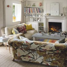 White period living room with statement sofa | Take a look at this quaint cottage in West Sussex | housetohome.co.uk