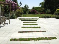 Designed by Lovely Lovely Lovely .Slots cut into slab to create separate areas on terrace