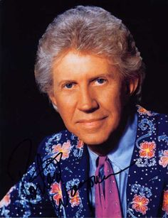 Porter Wagoner - ~~  Porter Wayne Wagoner was a popular American country music singer known for his flashy Nudie and Manuel suits and blond pompadour. Wikipedia Born: August 12, 1927, West Plains, MO Died: October 28, 2007, Nashville, TN Spouse: Ruth Olive Williams (m. 1946–1986), Velma Johnson (m. 1943–1943)