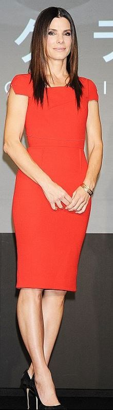 sandra bullock  Who made  Sandra Bullocks red pleated dress that she wore in Tokyo on December 4, 2013?