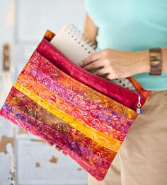 Sew an Everyday Pouch - a nice looking pouch - but use directions for other zippered pouches to avoid raw edges inside.