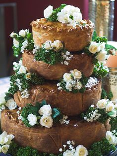 a savoury wedding-pie so buffet sorted!   According to Bray's Cottage Pork Pies  - or how about a stack of double crusted apple pies stacked like a wedding cake?????
