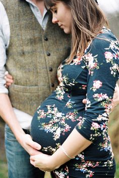 Beautiful maternity shot. Love that dress.