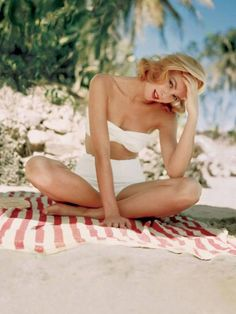 Grace Kelly photographed by Howell Conant in Montego Bay, Jamaica, 1955.