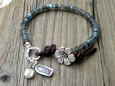 Beaded bracelet, Blue Flash Labradorite, Flower Button Leather Closure, Buddha Keishi Pearl, Bohemian Zen Jewelry Yoga Jewelry  This pretty bohemian layering bracelet has been created with lovely Blue Flash Labradorite Rondelles, silver components, a darling Buddha dangling from the hammered ring, with a luminous Keishi Pearl, and has been completed with aged Greek Leather and a floral button. It will comfortably fit a 6 3/4-71/4 wrist, but if you need it sized for you, just send me a convo…
