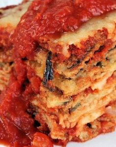 *Eggplant Parmesan Casserole: - Eggplants - Whole Wheat Flour - Eggs - Low Fat Milk - Seasoned Breadcrumbs - Grated Parmesan Cheese - Oil - Sliced Provolone - Shredded Italian Cheese Blend - Sweet Onion - Garlic Cloves - Crushed Tomatoes - Tomato Paste - Basil
