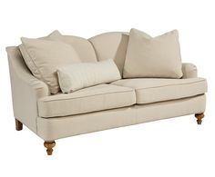 Dressed up but casual, the transitional details and neutral poly/linen  fabric makes this sweetheart back Adore Loveseat a go anywhere style. Its rounded  Charles of London arms blend nicely with tailored T-cushion seats,  turned wooden legs and a wood trimmed base.