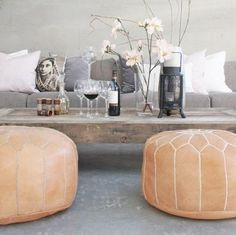 Our tan moroccan footstool adds some stylish extra seating for your living room.