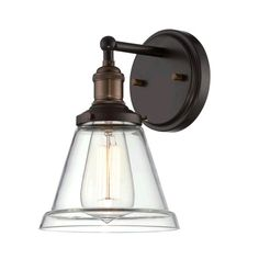 - Overview - Details - Why We Love It - We absolutely adore this vintage-industrial sconce, don't you? It'll bring so much character to your bathroom or hallway. Plus, with the variety of glass shade