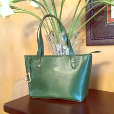 "Ralph Lauren Classic Tote Ralph Lauren hunter green tote. Genuine leather handbag with gold hardware. Inside zip pocket with cell phone pocket. 3 additional inside pockets with key hook. Dimensions: 14.5"" x 9"" x 4.5"" Ralph Lauren Bags Totes"