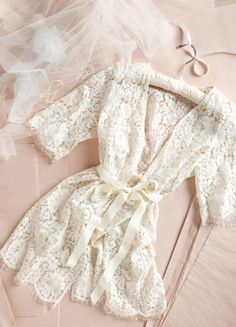 lace robe while getting ready for the big day