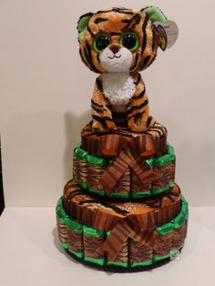 This yummy candy cake features Ty's® Beanie Boos® Tiger and comes with a matching plush key chain! Makes a wonderful gift for a new mom! ©2013 Favors by Dorinda This item is no longer available