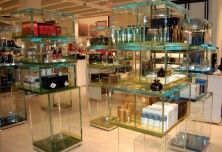 UV Bonded frameless glass fixtures for showcases in choice of glass, edgework and finish. We are the industry leaders with superior workmanship and fast turnarounds.  #imagicglass #framelessglasscases
