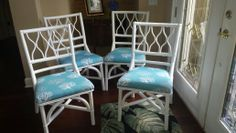 Rattan Dining Chairs - painted and recovered seats in aqua fabric with coral fabric.