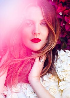 #DrewBarrymore looking spring-ready with a red lip and tousled #hair.