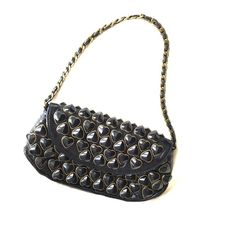 Betsey Johnson metal heart clutch shoulder bag Black metal hearts with brass gold trim with the chain linked shoulder bag. Two harts missing in the back of the back. Very cute/ fun accessory Betsey Johnson Bags Shoulder Bags