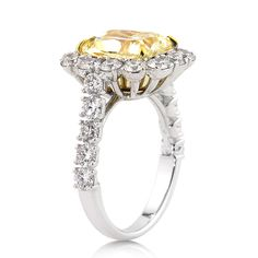 Markbroumand.com #2812-1  http://www.markbroumand.com/5.50ct-fancy-yellow-cushion-cut-diamond-engagement-anniversary-ring-2812-1d37951754/