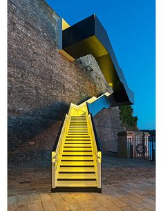 As part of the regeneration of the 19th-century Royal William Yard in Plymouth, England, Gillespie Yunnie Architects designed a staircase to connect pedestrians from the former naval supply yard to the South West Coast Path, a 630-mile trail that runs from Minehead in Somerset to Poole Harbour in Dorset. Concealed LED lights change the color of the stairwell. Photo: Richard Downer