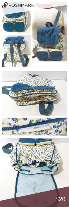 """Mary Kate & Ashley Backpack The Row 90s Grunge Mary kate & Ashley mini denim & floral backpack Total collectors item!  This is before 'the row' & those $10,000 pill backpacks lol Approx Measurements Laid Flat 4"""" Width x 14"""" Height x 10""""Length w/ adjustable strap.  Super 90s -2 square pockets on front & zipper pocket inside.  Excellent condition! mary kate & ashley Bags Backpacks"""