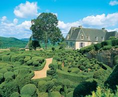 Dordogne, France.... I think I could walk forever in these garden paths. I would surely love to try, if anything~