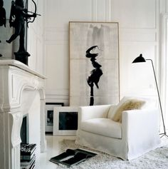 the drama of black and white art in an all white room