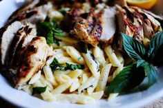 Lemon basil chicken and pasta -no need to marinate, just brush and grill; on the light end of lemon range is good