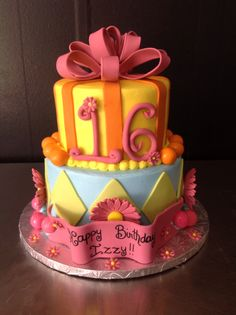 2 tier with a buttercream base and a fondant accents with a bubblegum border