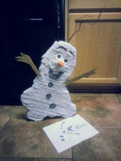 Olaf the snowman  pinata for Frozen theme birthday party.do you want to build a snowman???? Total cost= $3 for tape, glue, tissue paper.cardboard is free. craft time 3hr. Joy= immeasurable.